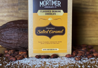 Salted Caramel Drinking Chocolate as a lifestyle image surrounded by salt, cocoa pods and cocoa beans